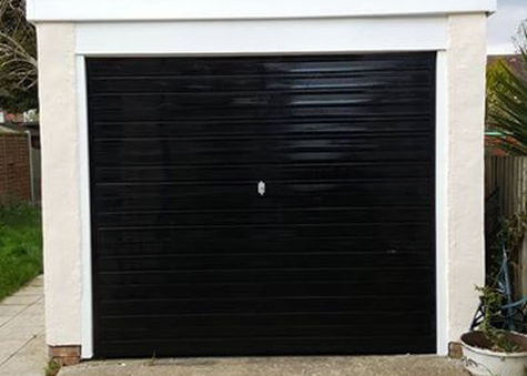 Precision Roofing and building maintenance garage
